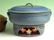 Food Warmer from Stoneware Pottery. What a beautiful way to present a dish & keep it warm!