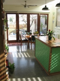Kitchen made from wood from Royal Botanic Gardens Melbourne. Albert Park Railway Station and Botany bay wool stores.  Recycled concrete floors.