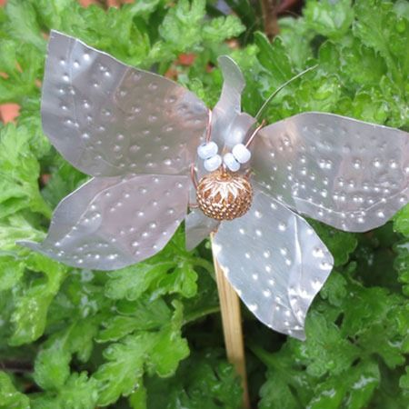 Recycled Can Crafts  :: tutorial to make this adorable Butterfly