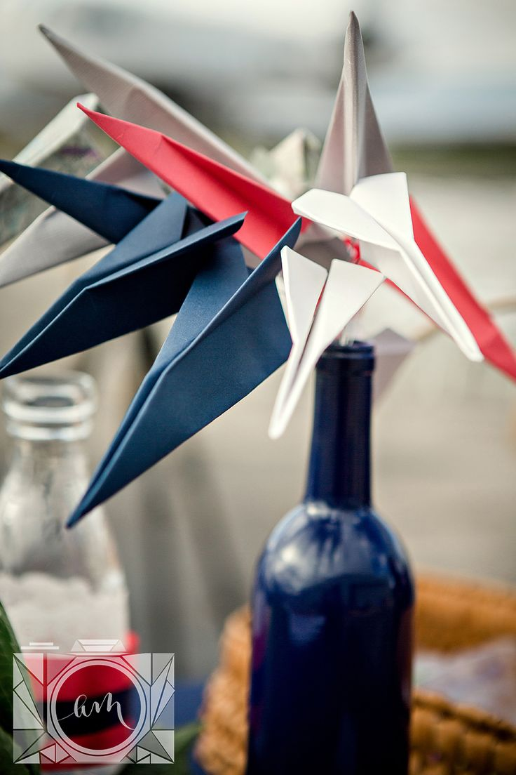 Paper Airplane Centerpiece Picture In An Airplane Hangar