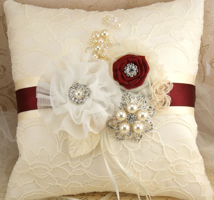 Ring Bearer Pillow Bridal Pillow Wedding Pillow in Ivory and Burgundy with Lace, Brooch, Jewels and Pearls. $125.00, via Etsy.