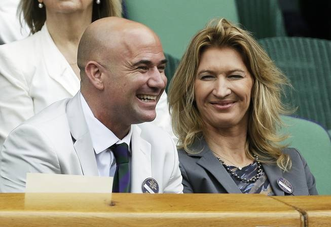 Andre Aggasi and Stephi Graff.  England Lawn Tennis Championships at Wimbledon, England, July 4, 2012.