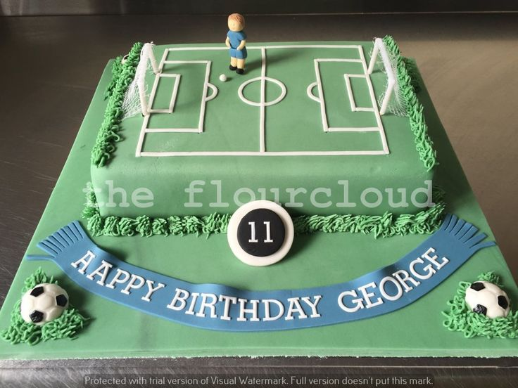 Football pitch birthday cake.