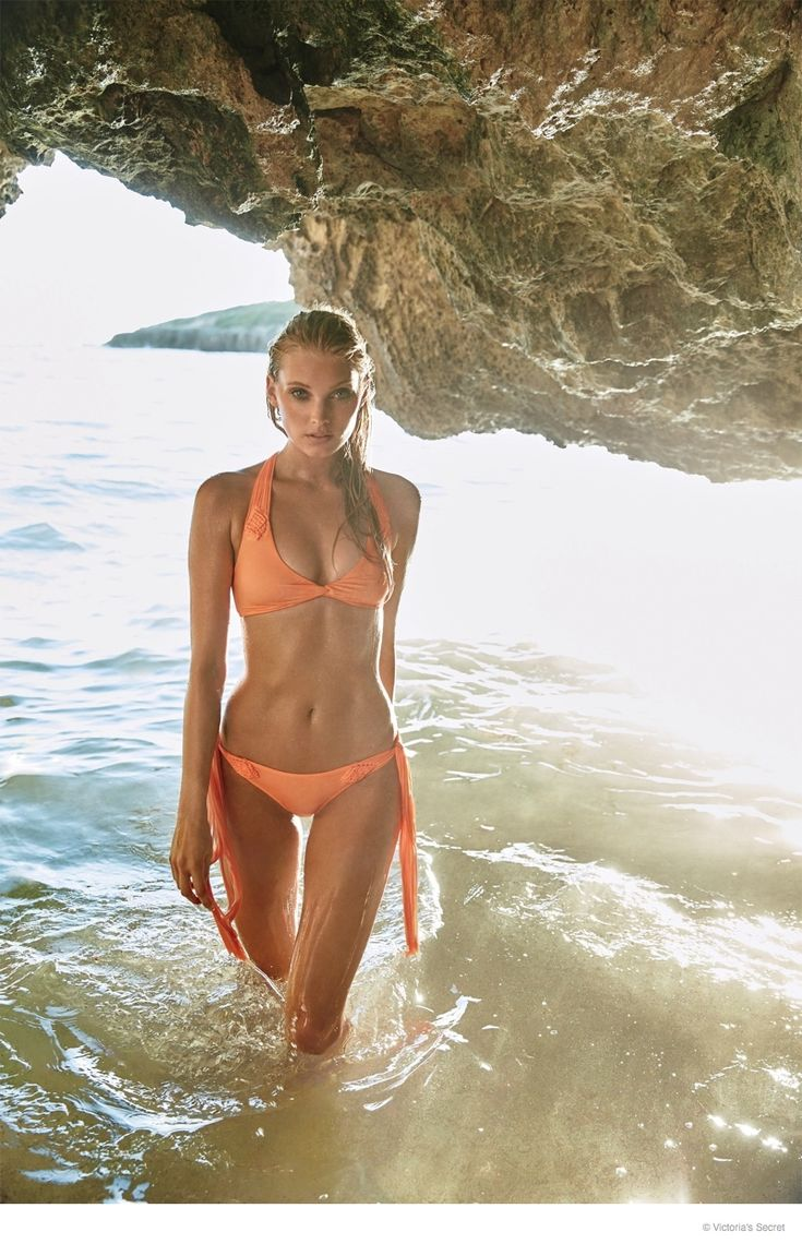 Elsa Hosk models an orange bikini in the VS Swim catalogue.: