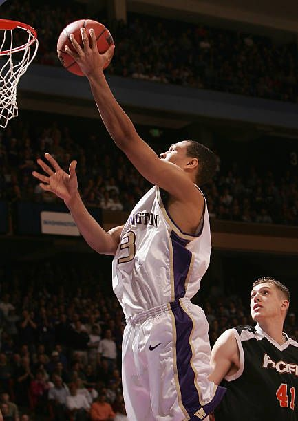 Brandon Roy of the Washington Huskies lays up a shot past Tyler Newton of the Pacific Tigers during the 2005 NCAA division 1 men's basketball...