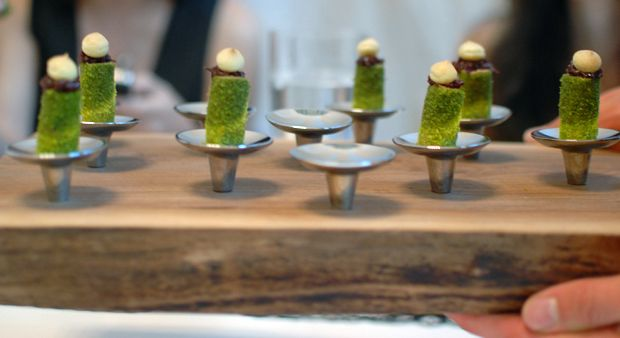 the serving dish has been cleverly created to use cabinet knobs to present the basil crusted filet mignon