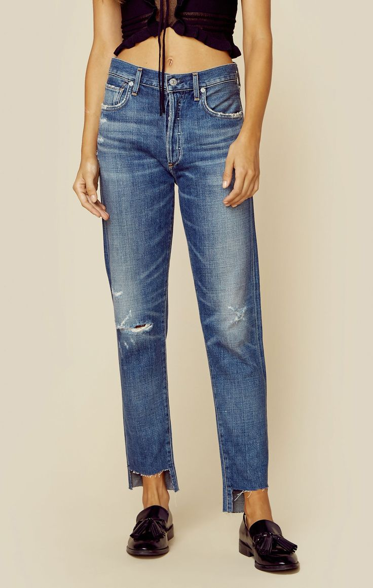 "These laid-back Citizens of Humanity jeans feature a whiskered wash with frayed edging, raw high-low hem, and 5-pocket styling. Made in USAWash Cold77% Cotton 23% RayonFit Guide:Model is 5ft 7 inches; Bust: 32"", Waist: 24"", Hips: 34""Model is wearing a size 24Hi Rise Relaxed FitShoes Featured Not Available For Purchase"