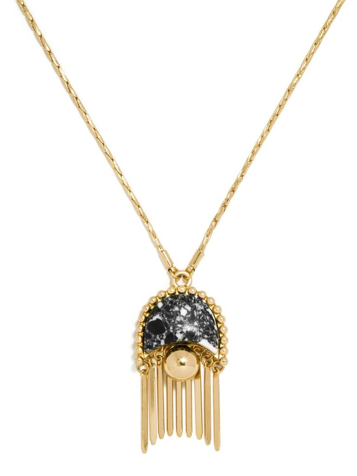 This pendant featuring a shield-shaped silhouette of statuesque howlite is extra striking thanks to gold fringe.