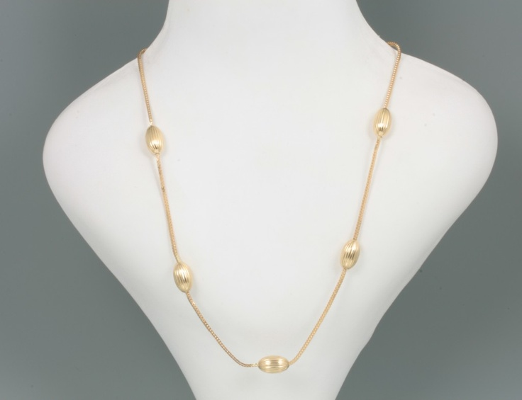 """This 18 karat yellow gold necklace has an interesting design incorporating 11 oval corrugated style melon beads that are each welded to a heavy square snake chain. The necklace is 30"""" long with a large spring ring in excellent working condition. The piece is stamped """"750"""". The necklace weighs 20 pennyweights or 31.2 grams. This is a very distinctive necklace in well polished high karat gold. http://rekitch.com/?wpsc-product=18kt-gold-beaded-necklace $2,525.00Design Incorporated, Karate Yellow, Excel Work, High Karate, Melon Beads, Gold Necklaces, Basil Rekitch, Large Spring, Karate Gold"""