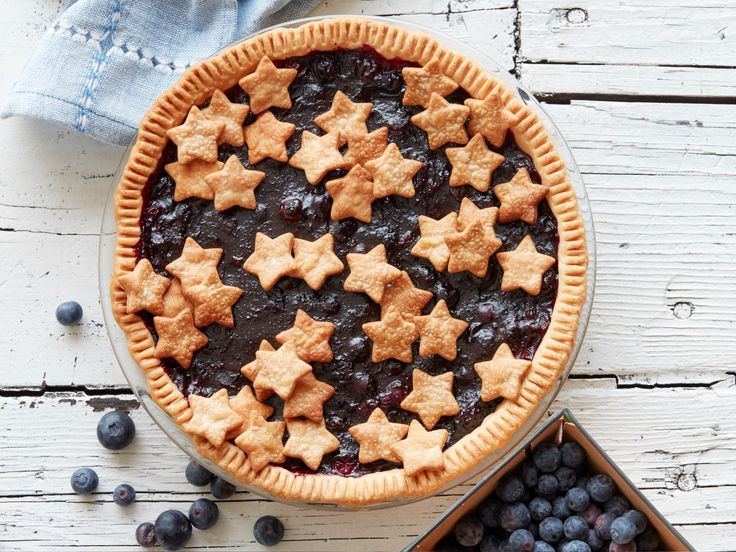 Blueberry Pie : Get creative with the placement of the stars on this patriotic pie. Try layered clusters for a rustic look, or stand the stars up slightly as you press them into the filling, so they look like they're pledging allegiance to the flag.