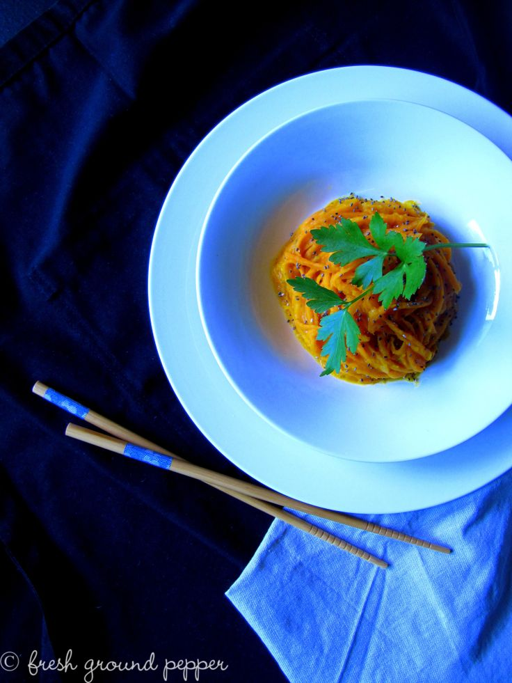 raw carrot noodles with creamy butternut squash sauce, chia seeds and parsley