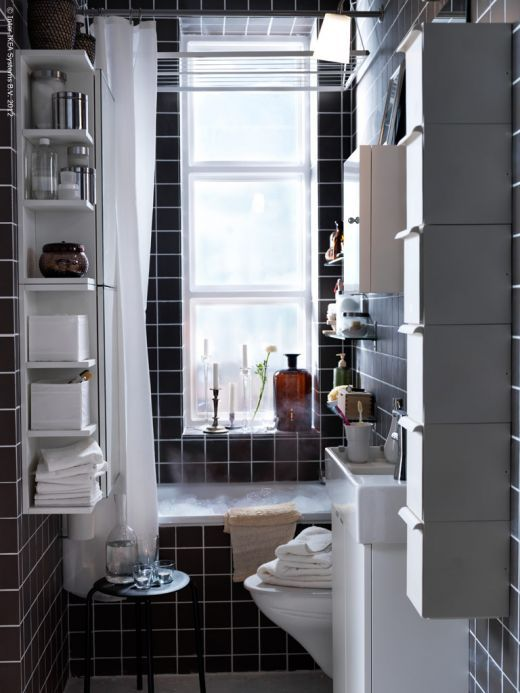 Love the use of a dark 6x6 tile as a simple yet stylish bathroom design! This is a inexpensive way to create a good looking bath!