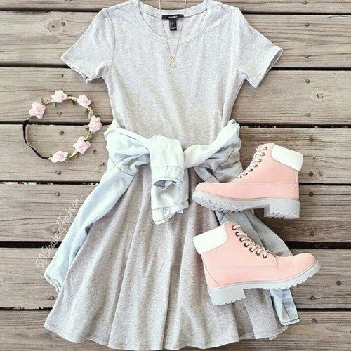 Casual girly outfit with the light grey tee shirt dress, denim top tied around the waist, floral crown, and timberlands