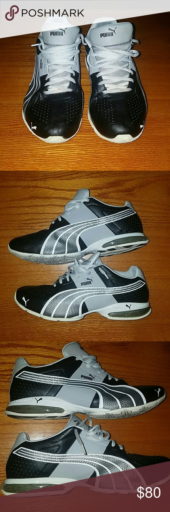 Mens Pumas Nice Mens puma running shoes. BLACK leather with silver Puma stripes. Used but plenty of out on the town or running wears left. Puma Shoes Athletic Shoes