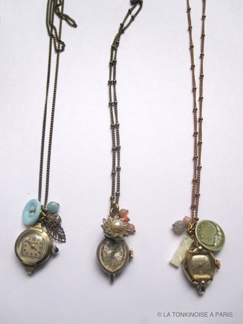 Old watch faces used as pendants.