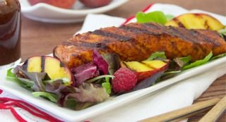 Gluten-Free Sweet Chili-Rubbed Salmon with Grilled Peach and Raspberry Salad: An awesome flavor combination of grilled chili and brown sugar-rubbed salmon served on lettuce with grilled peaches, raspberries and orange vinaigrette.