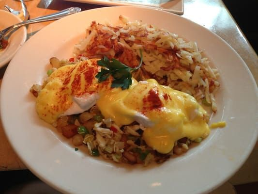 Menu Description: A Delicious Blend of Sauteed Crab, Red, Yellow and Green Peppers, Onions and Potatoes. Topped with Poached Eggs and H...