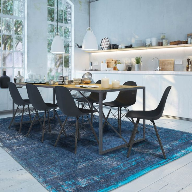 Interior Design Ideas 2016 A Blue Rug Sits Under Dining Room Furniture