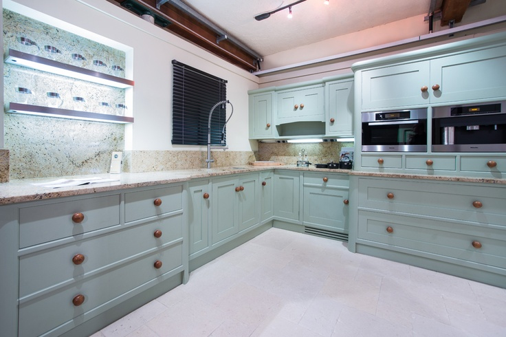A traditional kitchen in our showroom. This bespoke furniture has been painted in Farrow and Ball paint.