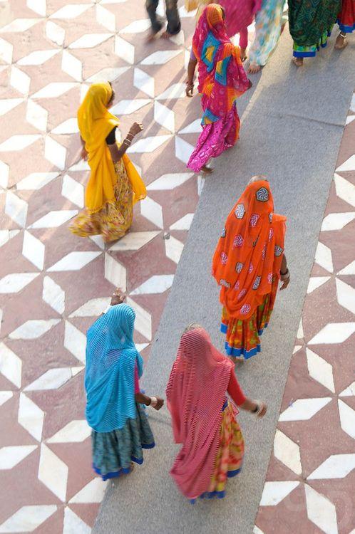 Colorful ladies on a Mahalaxmi patterned flooring