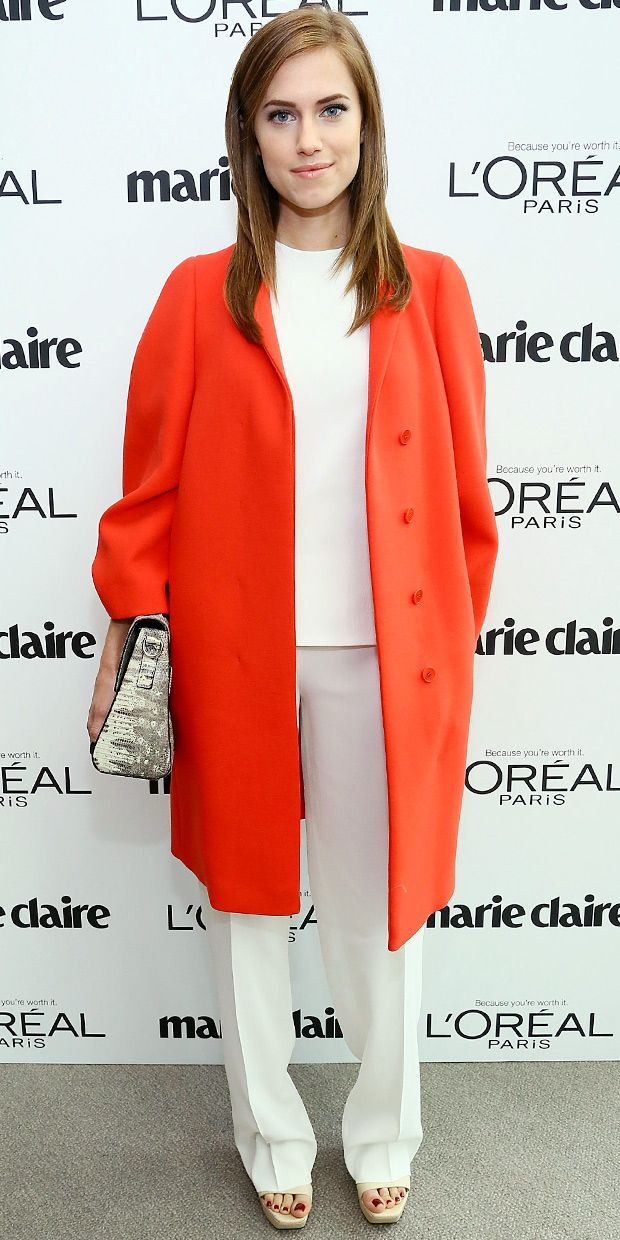 Allison Williams Arrives At Marie Claire's Power Women Lunch wearing Calvin Klein Collection (Love her orange coat!)