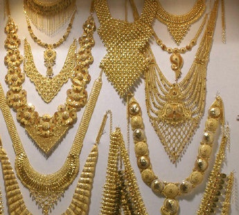 hand crafted gold necklaces on display in Dubai