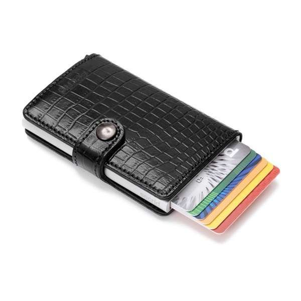 Secrid's aluminium Card Protector is an ingenious design and the core of the Secrid wallet. It protects your cards against breakage, bending and skimming, which can lead to identity and information theft. The Secrid Mini Wallet includes a leather exterior that's attached to the Card Protector to carry notes, receipts and additional cards. The easy to close press stud ensures all contents stay safely locked within the wallet. The Card Protector can hold up to five cards... read more @ Make