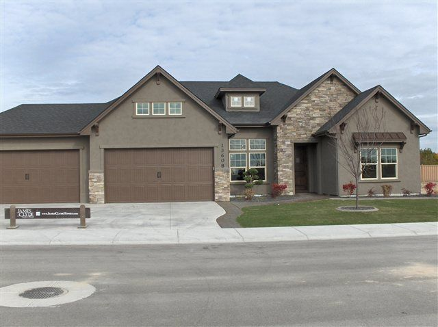 Taupe stucco darker garage doors alma 39 s house for Garage door colors