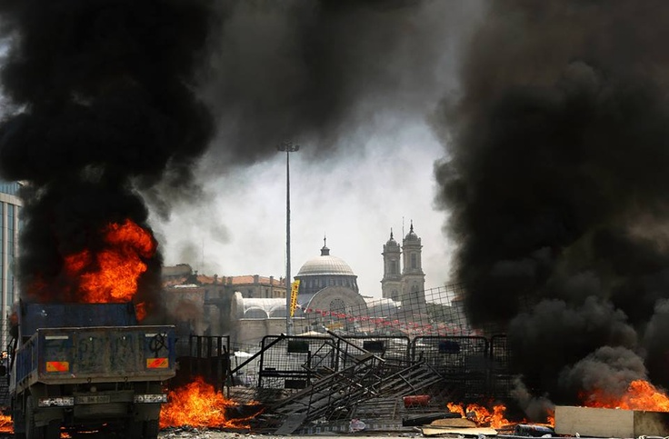 The Greek Orthodox Church of Hagia Triada, framed by a burning barricade during clashes in Istanbul's Taksim Square, on June 11, 2013. (Reuters/Yannis Behrakis) - Via In Focus: http://theatln.tc/11dnSys
