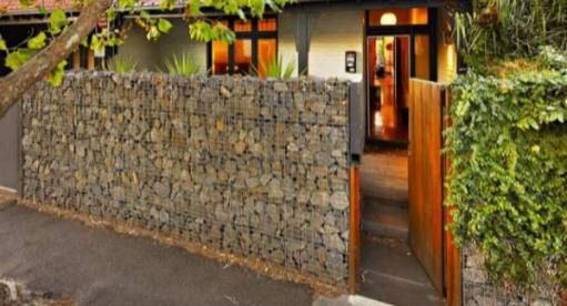 Cheap Fence Ideas | Gabion Stone Fences Simple Low Cost Stone Fencing. Maybe this with english moss growing on it that would one day eventually cover it.