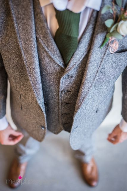 Our groom wore the perfect combination of a classic yet modern outfit, all supplied by Dawes. It pulled in the greys and soft greens that are perfect against copper and black
