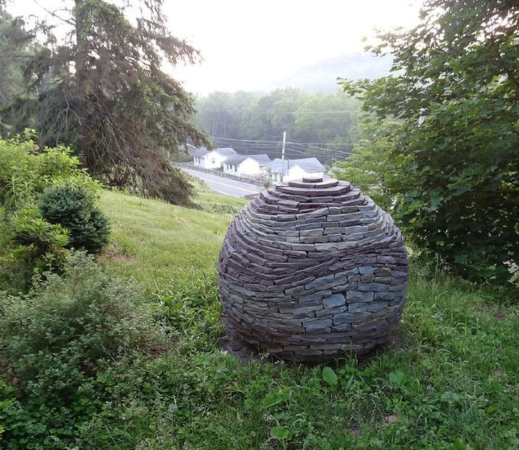 9822074_stacked-stone-garden-spheres-by-devin-devine_t45dac1ec.jpg 800×694 pixels