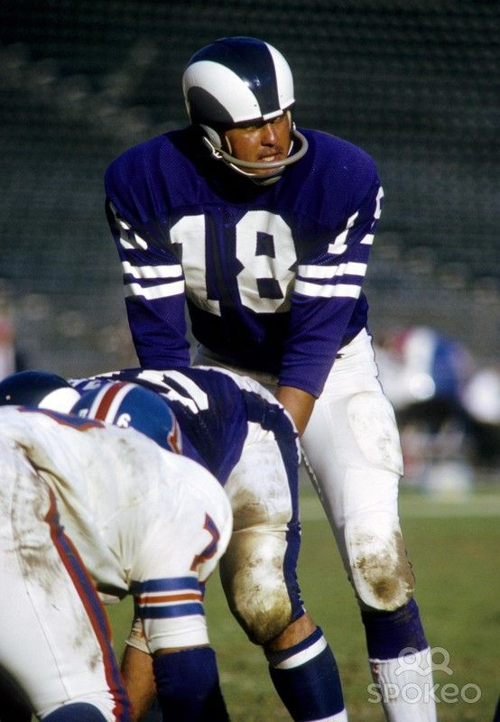 Los Angeles Rams quarterback Roman Gabriel (18) at the line of scrimmage against the Denver Broncos at the Coliseum.