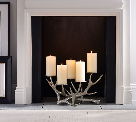 http://www.potterybarn.com/products/antler-fireplace-candleabra/?pkey=cweekly-flash