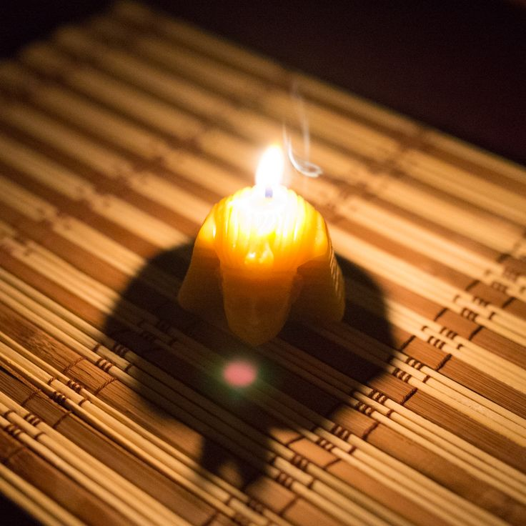 Burning beeswax candle