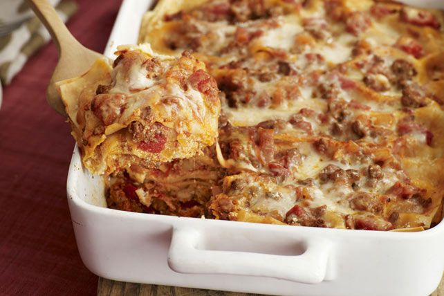 This Lasagna Formaggio (Italian for cheese lasagna!) is sure to become your go-to lasagna recipe.  Loaded with cheese, saucy ground beef and tender lasagna noodles, this oven-baked pasta classic has all-family appeal.
