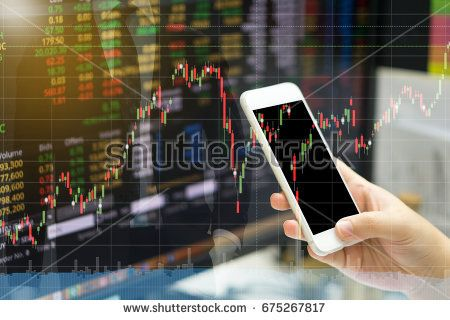 business finance concept. hand holding white smart phone with stock graph mixed with stock status and business man background and light effect