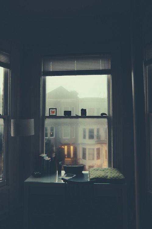 Creative space by misty morning window looking over city street
