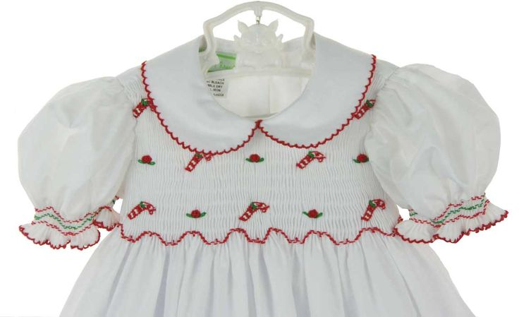 Little Threads white smocked dress with embroidered candy canes,white Christmas dress with candy cane embroidery,white smocked Christmas dress for baby girls,white smocked Christmas dress for toddler girls,white smocked Christmas dress for little girls,white smocked Christmas dress for big girls,matching sisters Christmas dress,Christmas portrait dress