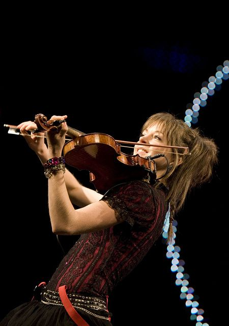 Lindsey Stirling - great violinist, dancer, and entertainer. However, it is the joy on her face when she plays that draws us in!