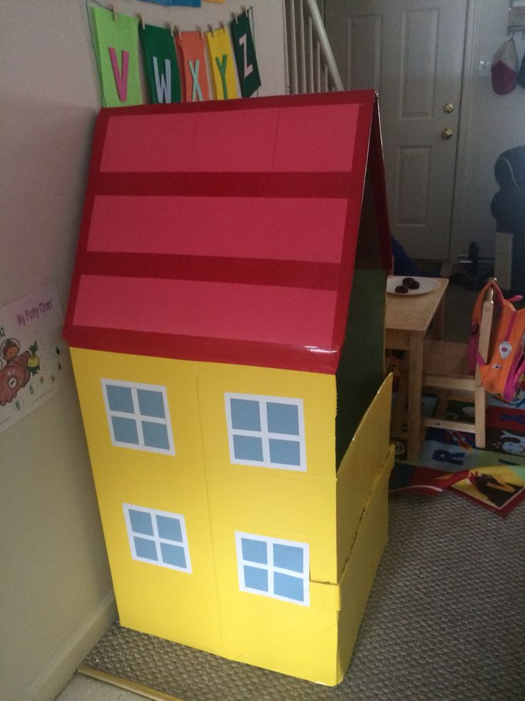 Peppa Pig Play house/ potty house. I made it from a cardboard box. It gives my kids some privacy while using their little potty in our family room. I made the front door lower so they can sit on the potty and watch TV too!