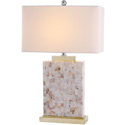Architectural in its graphic simplicity, the Shell Table Lamp's columnar base is artfully adorned with mosaic capiz shells and complemented by a transitional rectangular Geneva white shade. With brushed gold stand and fittings, this lamp casts an elegant glow in living room, hall or bedroom.