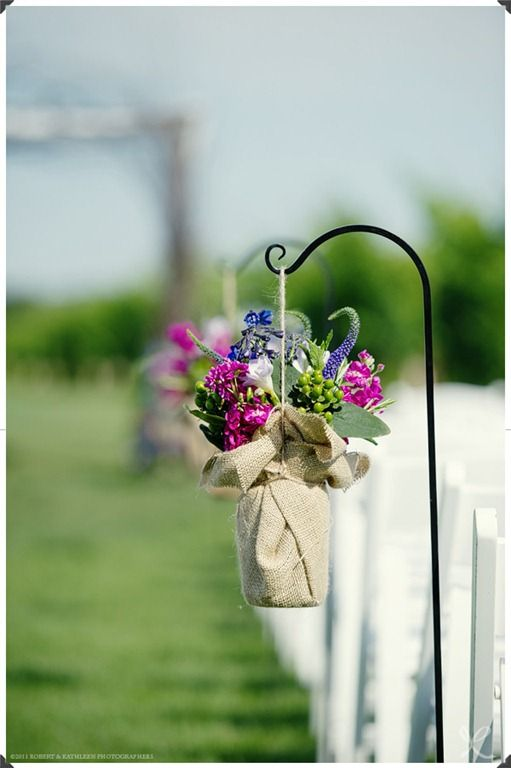 Wrap vase in fabric, hang from post-pretty!