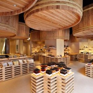 Kengo Kuma suspends wooden barrels  over Japanese soy-sauce shop