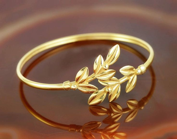 The olive leaves wreath adorned the head of every Greek goddess and emphasized the beauty of her femininity. The olive leaves golden bracelet available in my Etsy shop.