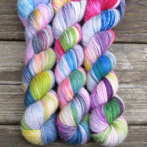 Perfectly Wreckless - Sojourn Sport - Babette Bright, wild, and kaleidoscopic, Perfectly Wreckless is predominantly hot pink with bursts of blue, green, yellow, black, and cream, all in varying amounts.  For even results, you must alternate skeins.Sojourn Sport is incredibly soft, with a bit of a sheen and halo. cashmere and silk Size: 200 yd / 2.4 oz (183m / 70g) skeins Content: 65% cashmere, 35% silk. Gauge: Sport weight. 5-7 stitches per inch on US 3-5. Care Instructions: Hand wash, dry…