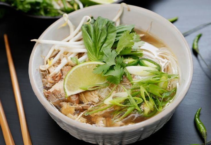 Our version of Vietnamese chicken pho features a homemade, aromatic broth topped with cilantro, lime, basil, and chili peppers for a bowl teeming with full-bodied flavor.
