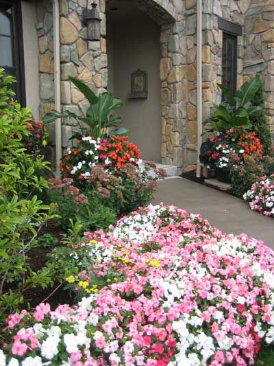 curb appeal - create an inviting entrance with planters, evergreens, and masses of impatiens