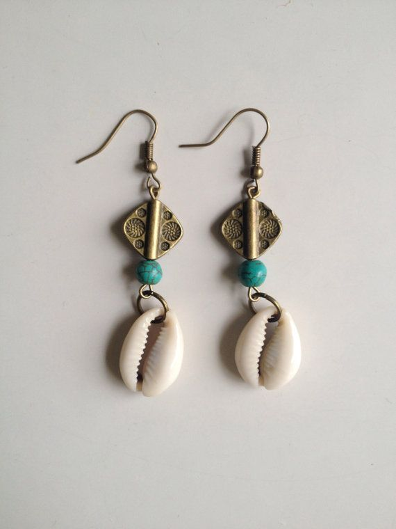 Cowry shell earrings with turquoise and brass by SuryaSoul on Etsy