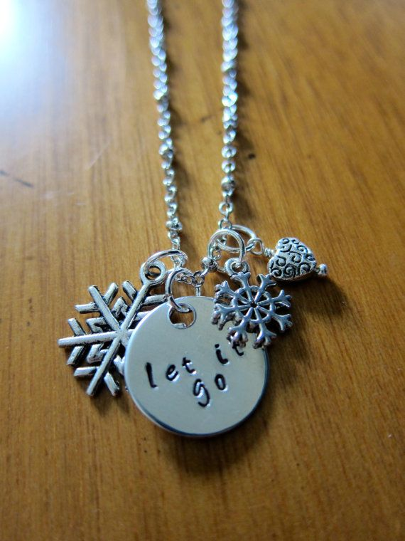 "Disney's ""Frozen"" Inspired Elsa ""Let It Go"" Necklace. Silver colored, snowflake, for women or girls."